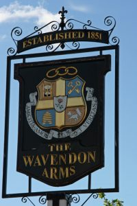 The pub sign at the Wavendon Arms